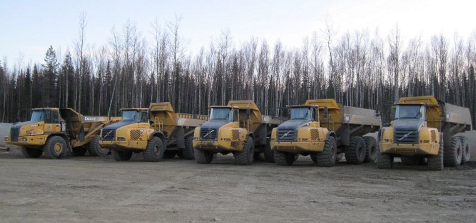 fleet of dump trucks